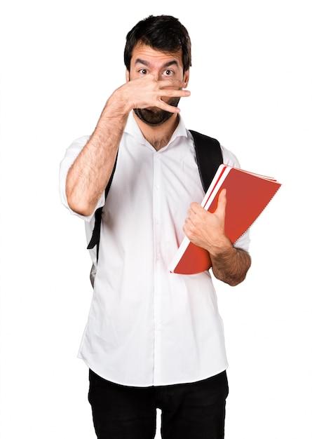 悪いジェスチャーを嗅ぐ学生の男 無料写真