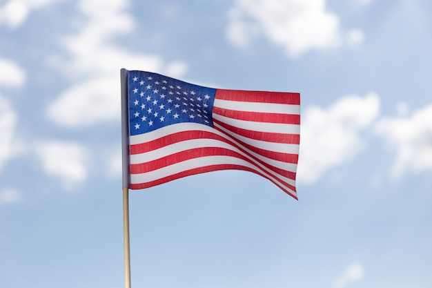 Американский флаг на голубом небе с облаками Premium Фотографии