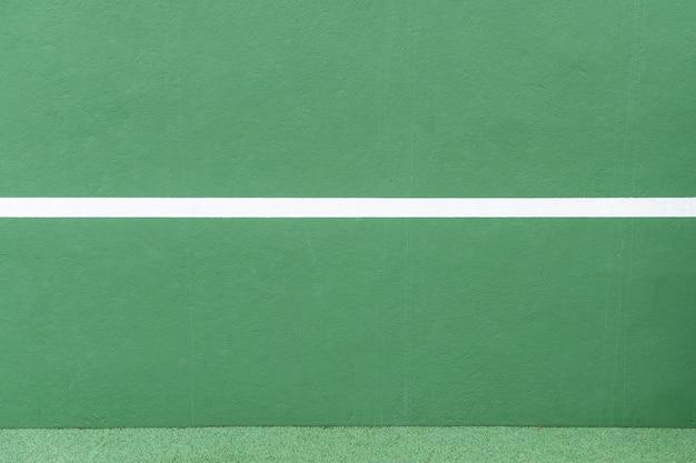 スポーツの背景。緑の壁と白い線 Premium写真