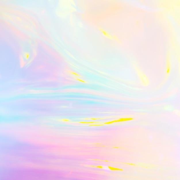 パステルカラーのホログラフィックプラスチック材料の抽象的な虹色の画像 Premium写真