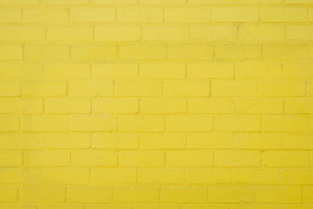 黄色のレンガの壁の背景の質感 無料写真