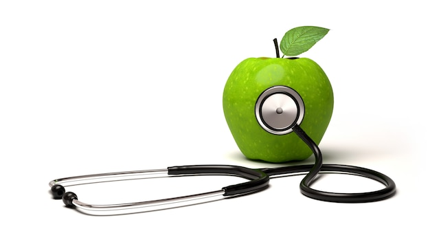 Стетоскоп и зеленое яблоко Premium Фотографии