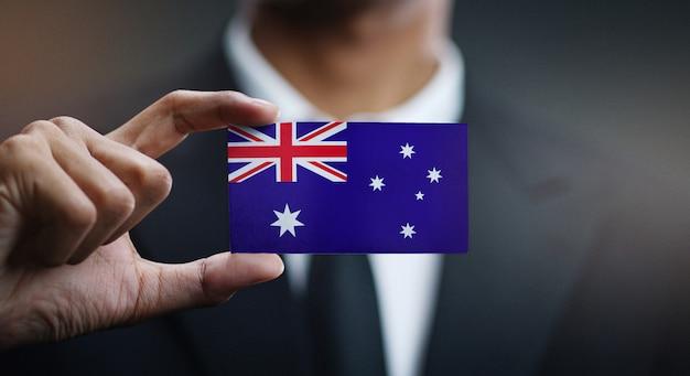 オーストラリアの旗の実業家保持カード Premium写真