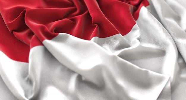 Индонезийский флаг украшен красиво размахивая макросом крупным планом Бесплатные Фотографии