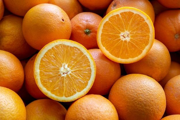 Много апельсинов из валенсии, испания. Premium Фотографии