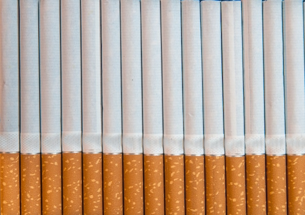 Крупный план табачных сигарет фон или текстура Бесплатные Фотографии