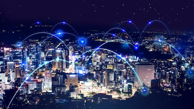 都市景観の夜景と抽象的なネットワークの背景 Premium写真