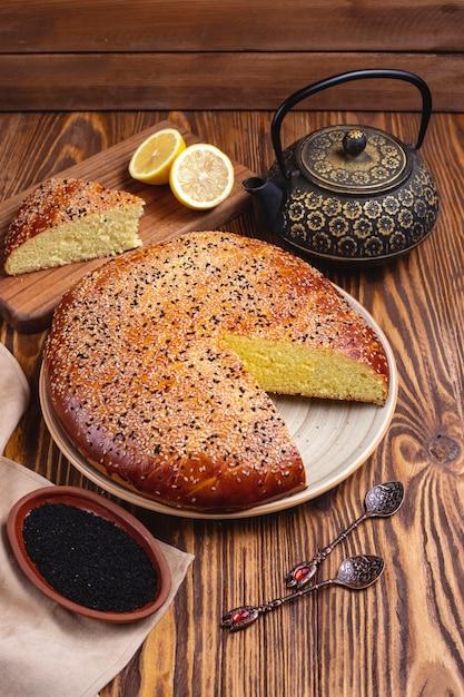 Лимонный пирог кунжутный чайник, вид сбоку Бесплатные Фотографии
