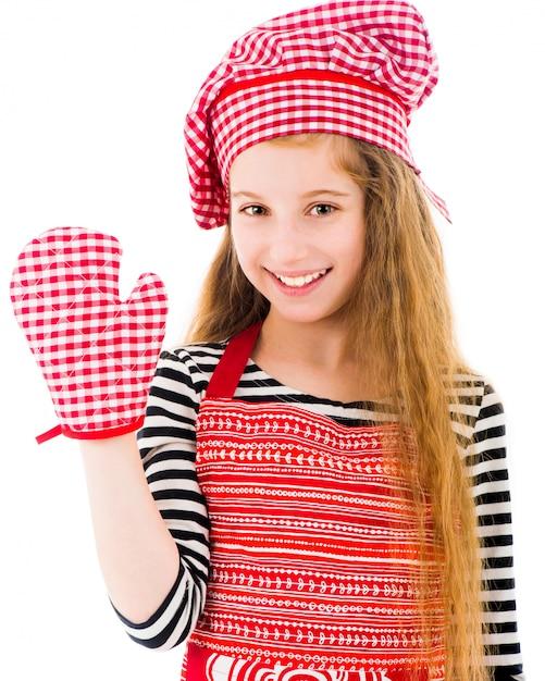 赤いエプロンとベーキンググローブの女の子 Premium写真