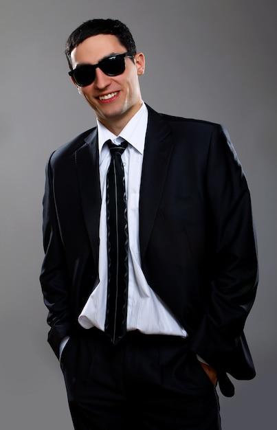 Молодой предприниматель в солнцезащитных очках Бесплатные Фотографии