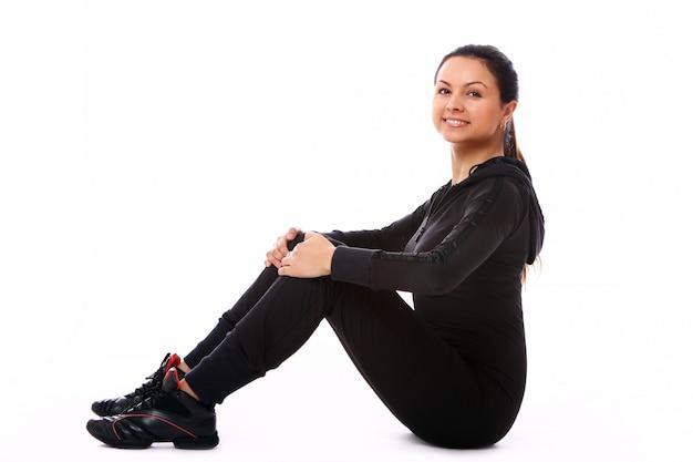若い女性のフィットネス運動を行う 無料写真