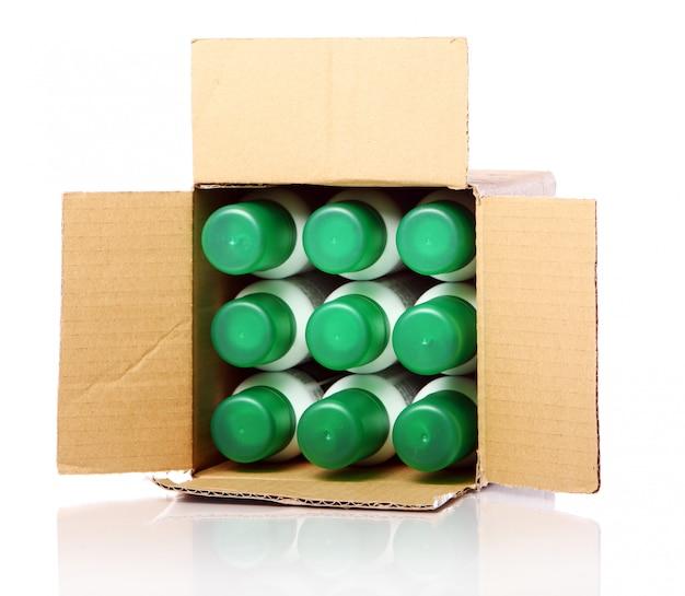 Картонная коробка с бутылками внутри Бесплатные Фотографии