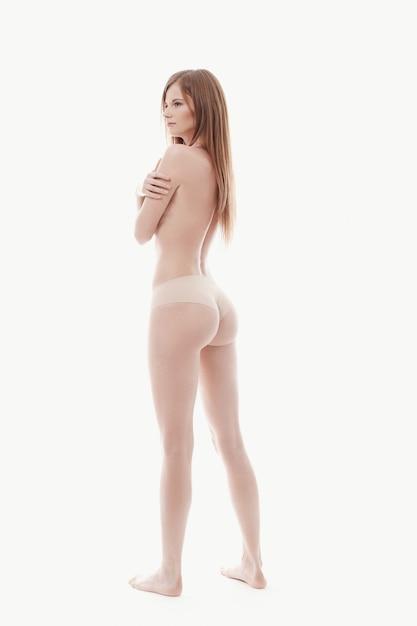 若い女性がトップレス、完璧な肌、背面ビューのポーズ 無料写真