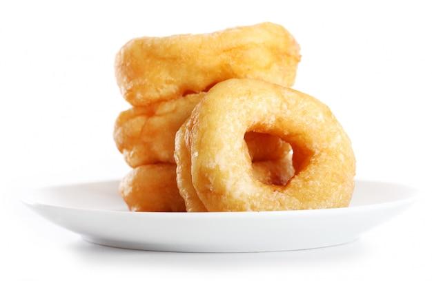 Вкусные красочные пончики на тарелке Бесплатные Фотографии