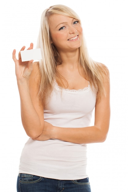 空のカードを持つ若い魅力的な女性 無料写真
