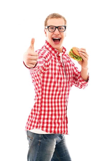 Смешной человек в очках ест гамбургер, изолированных на белом Бесплатные Фотографии