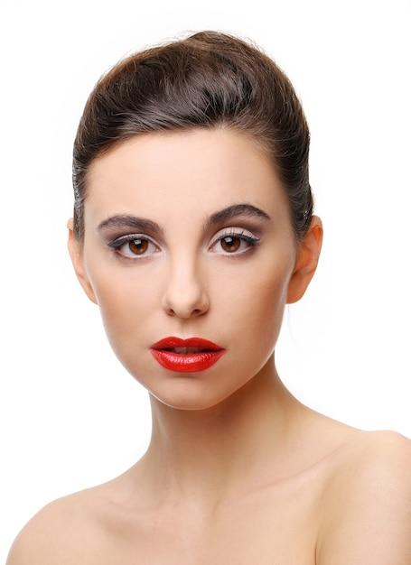 完璧な肌と赤い口紅の美しい少女 無料写真