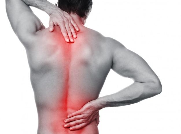 彼の背中の痛みを持つ男 Premium写真