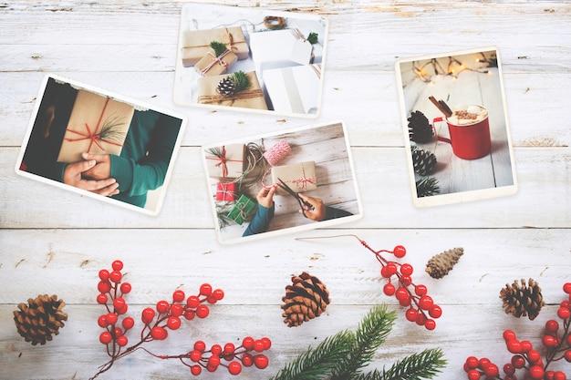 木のテーブルのクリスマス(冬季)の思い出とノスタルジアのフォトアルバム。レトロなカメラの写真 - ヴィンテージとレトロスタイル、トップビュー Premium写真