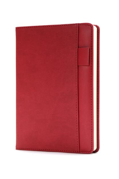 白い背景で隔離赤い日記 Premium写真