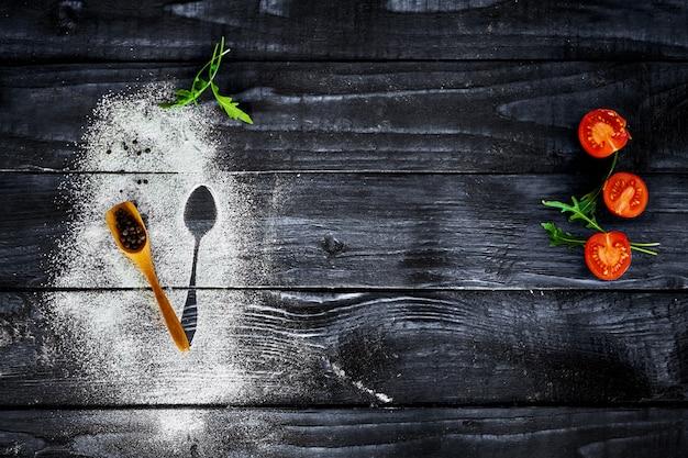 茶色のキッチンテーブルの上の野菜 Premium写真