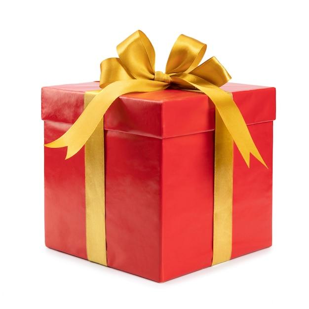 Красный подарок с золотым бантом Premium Фотографии