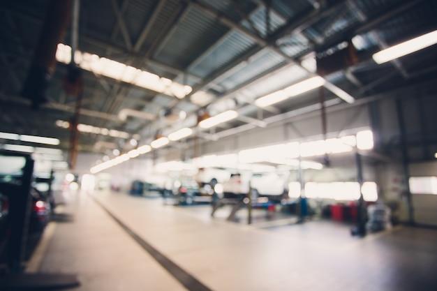 Абстрактное размытие гаража и автомобиля интерьера для фона обработка синего баланса белого Premium Фотографии