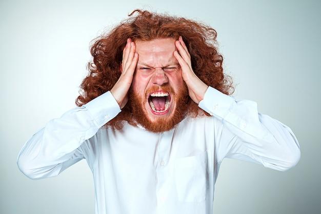 頭痛の種を強調した実業家 無料写真