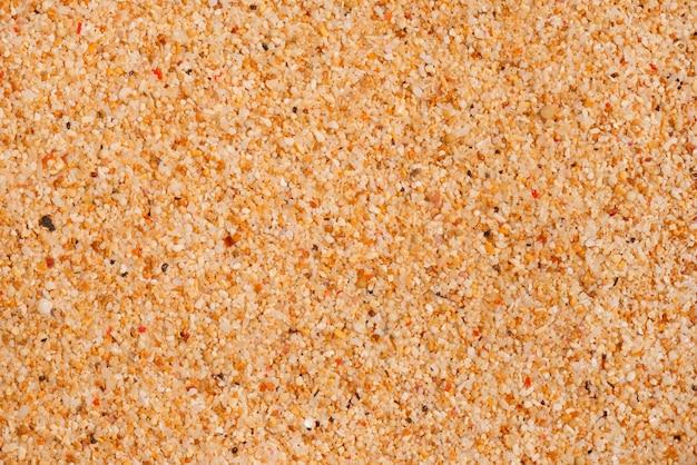 Макро текстура пляжного песка Premium Фотографии