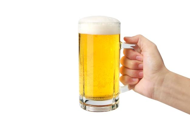 分離された手でビールのグラス Premium写真