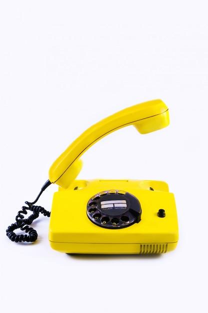 Ретро желтый телефон Premium Фотографии