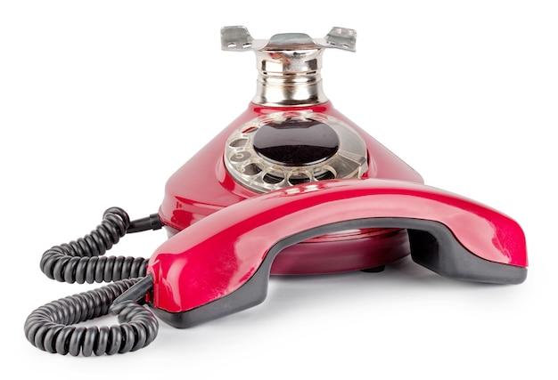 Красный старый телефон с крючка Premium Фотографии