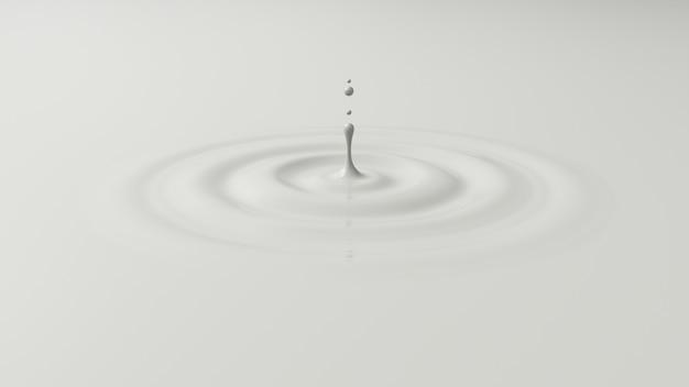 ミルクの表面に落ちるドロップ。白い液体のしぶき。 Premium写真
