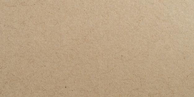茶色のパノラマ紙表面の質感とコピースペースの背景。 Premium写真