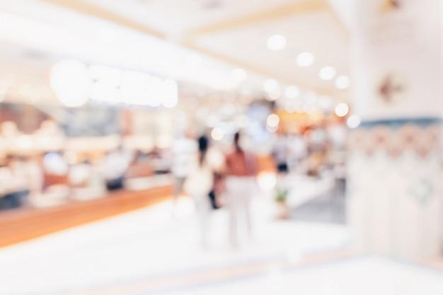 抽象的なショッピングモールの背景群衆人をぼかし Premium写真