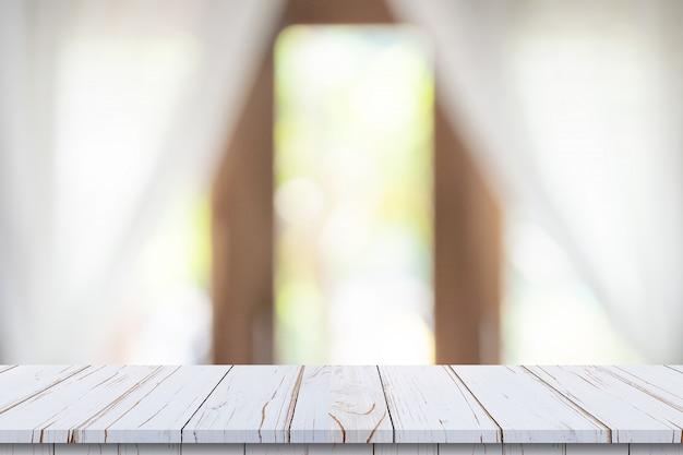 Пустая деревянная столешница на размытие белый фон окна. для монтажа продуктов или продуктов. Premium Фотографии