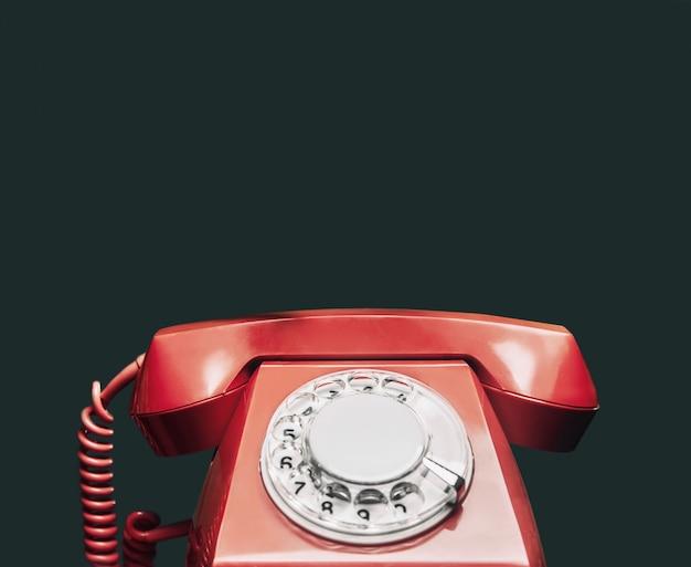 ヴィンテージの赤い電話。 Premium写真