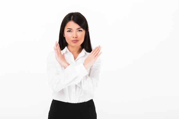 停止を示す深刻なアジア女性実業家の肖像画 無料写真