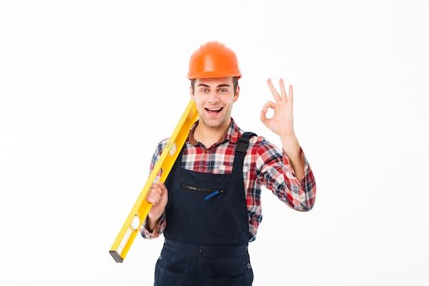 Полная длина портрет успешного молодого мужского строителя Бесплатные Фотографии