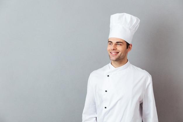 分離された制服立っている若い料理 無料写真