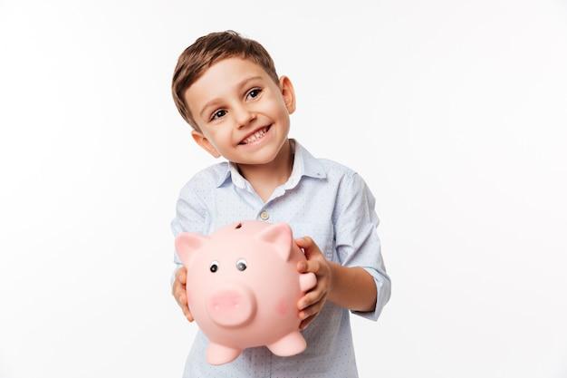 Портрет вишни милый маленький ребенок держит копилку Бесплатные Фотографии