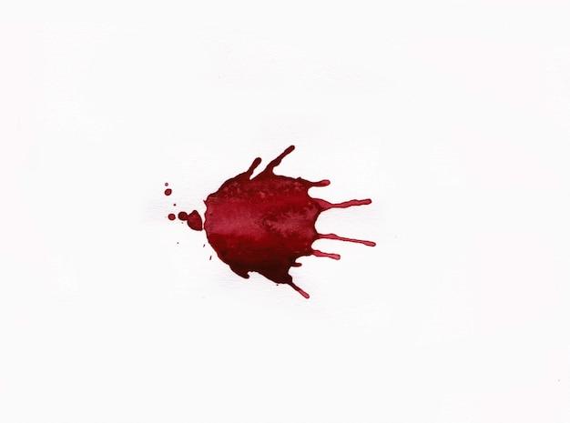 Брызги крови на белом фоне Premium Фотографии