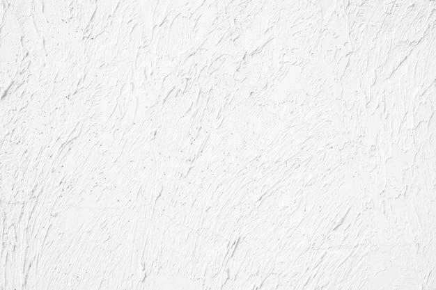 Предпосылка белой текстуры стены грубая. Premium Фотографии