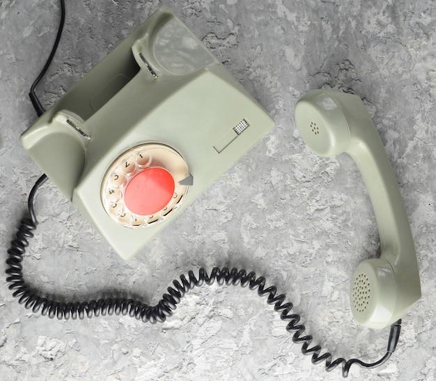 Ретро поворотный телефон. вид сверху. Premium Фотографии