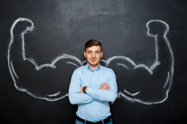 Картина смешного человека с поддельными мышц рук Бесплатные Фотографии