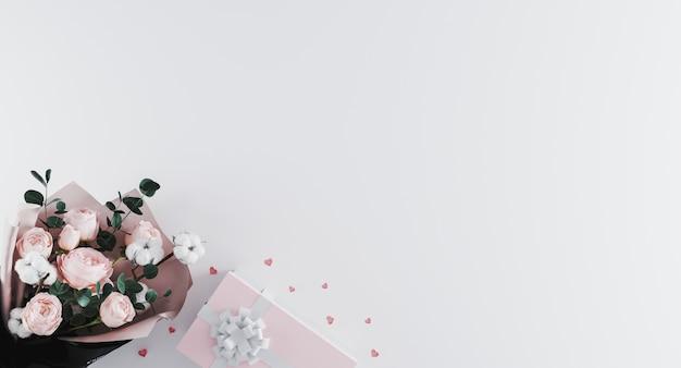 Красивый современный букет пионов с коробкой пинка присутствующей с белой лентой на белой предпосылке. Premium Фотографии