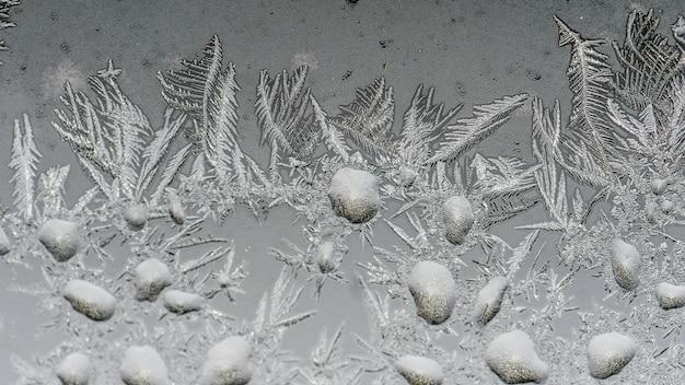美しい霜のパターンとガラスのテクスチャのクローズアップショット 無料写真
