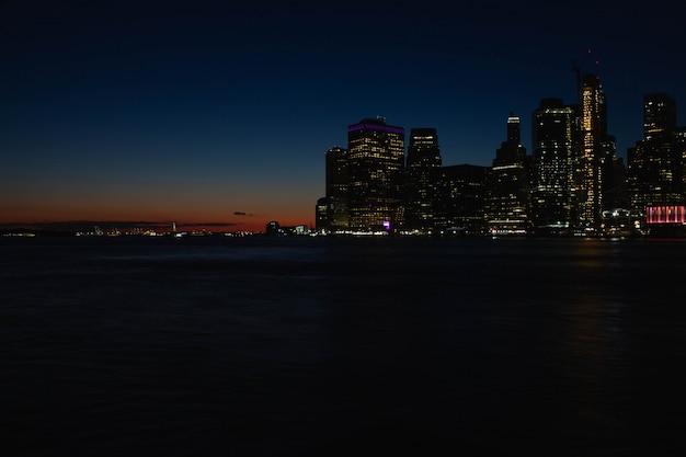 美しいマンハッタンの川と夕日 無料写真