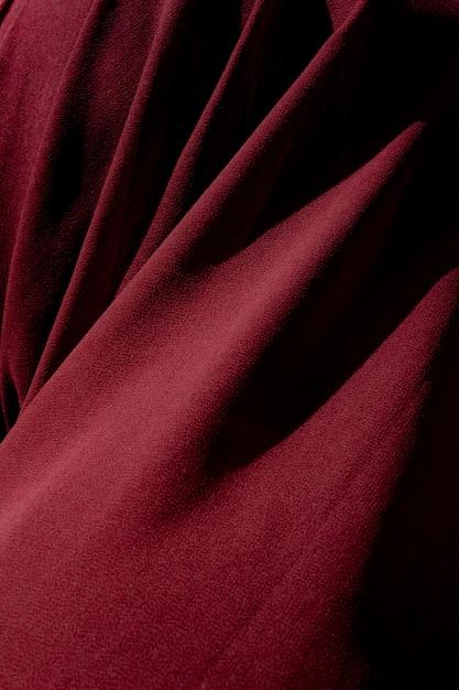 Вертикальная съемка красной ткани. это отлично подходит для фона Бесплатные Фотографии