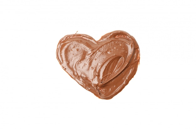 Вкусный шоколад в форме сердца на белом Premium Фотографии